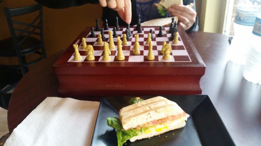 Playing chess over some lunch