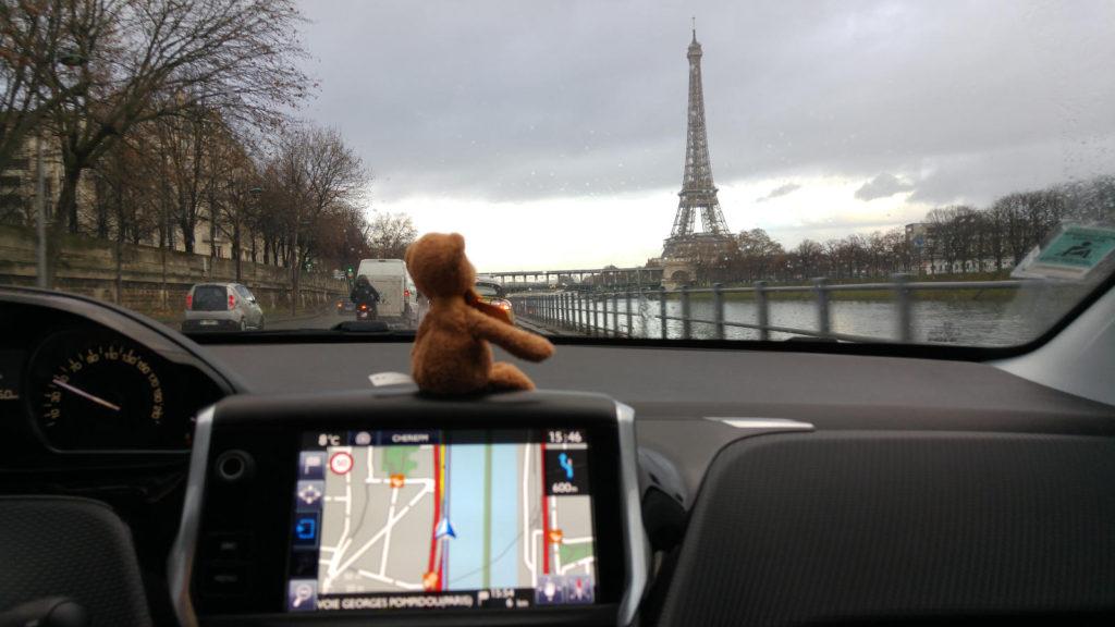 Flint driving near Eiffel Tower