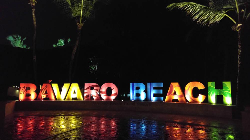 Bavaro Beach sign at night