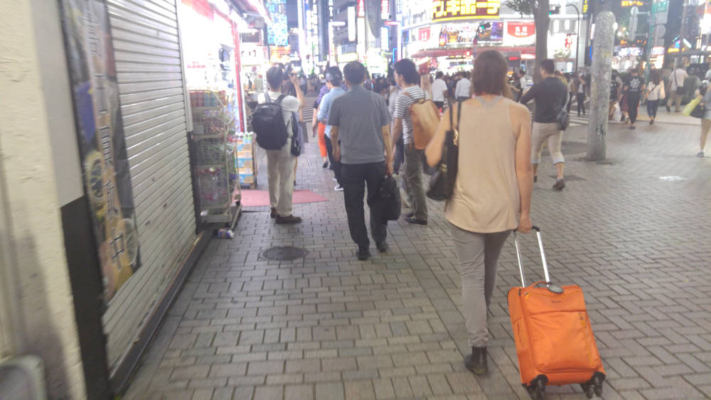 Walking in Tokyo with luggage